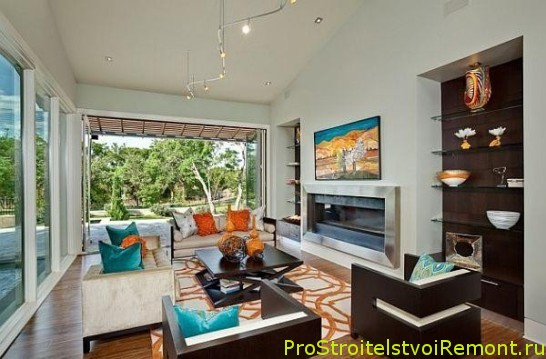 Дизайн интерьера гостиной с телевизором и цветами фото