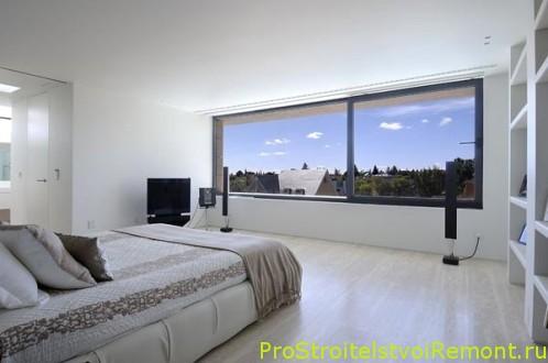 Дизайн спальни в белом цвете с современной кроватью фото