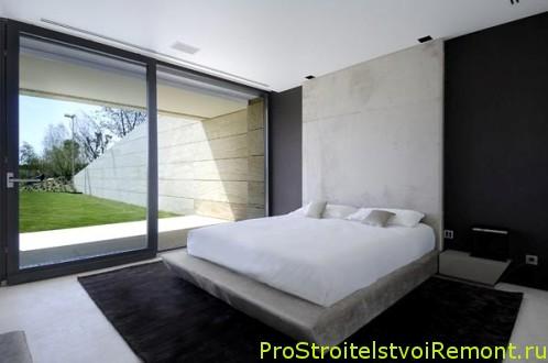 Современный дизайн спальни с большим окном фото